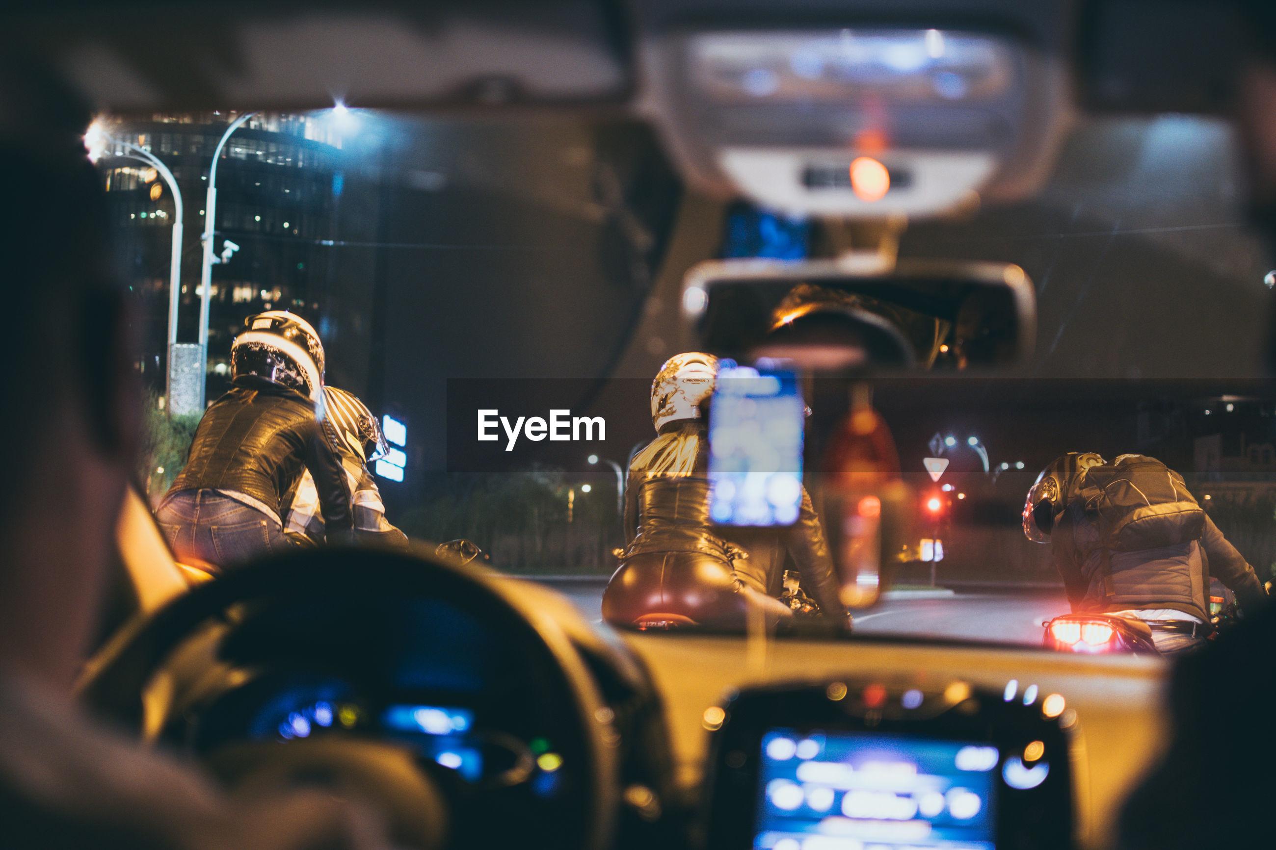 Man driving car on road at night