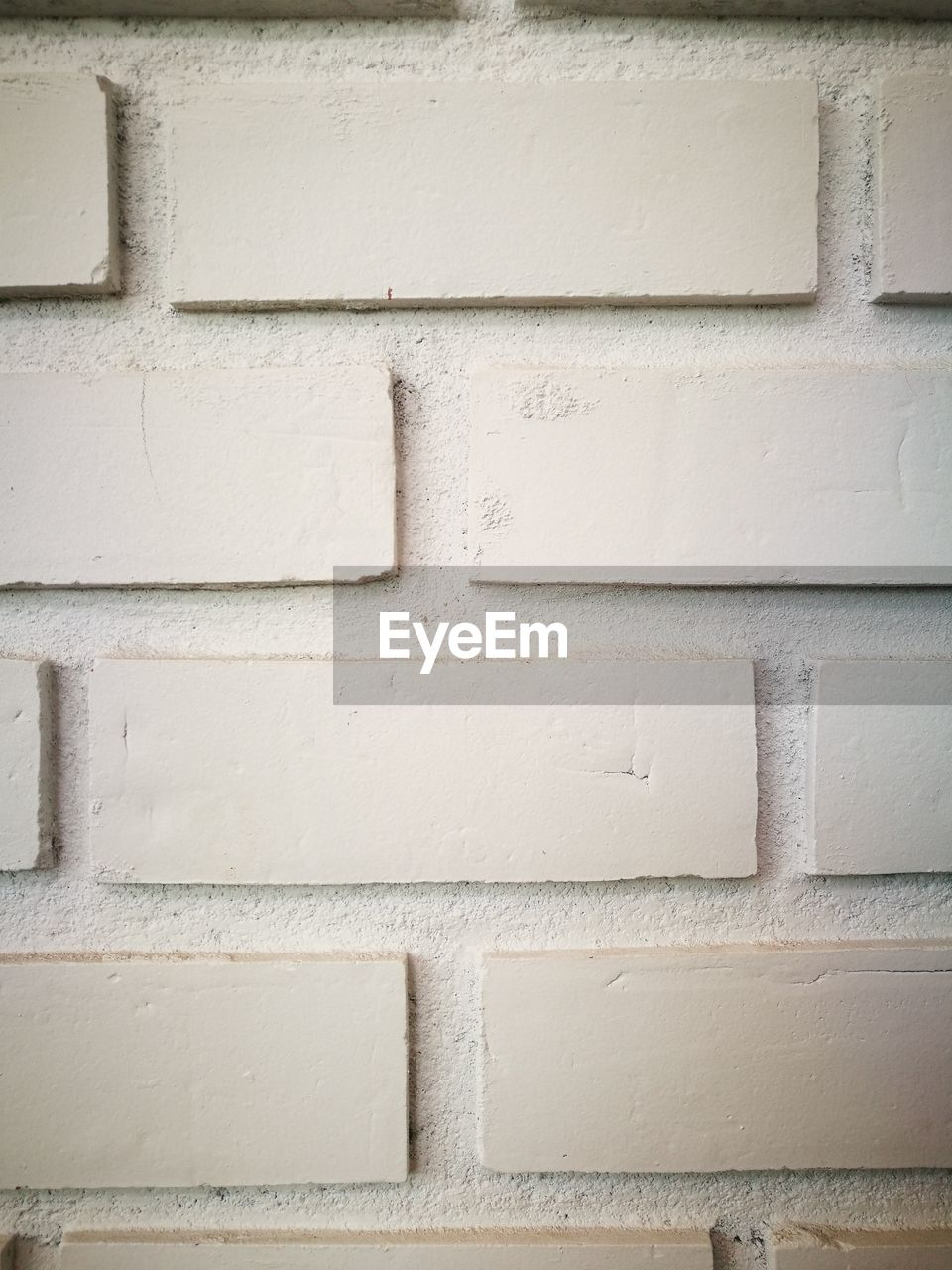 wall - building feature, brick wall, white color, built structure, architecture, building exterior, backgrounds, full frame, outdoors, no people, close-up, textured, paint, day