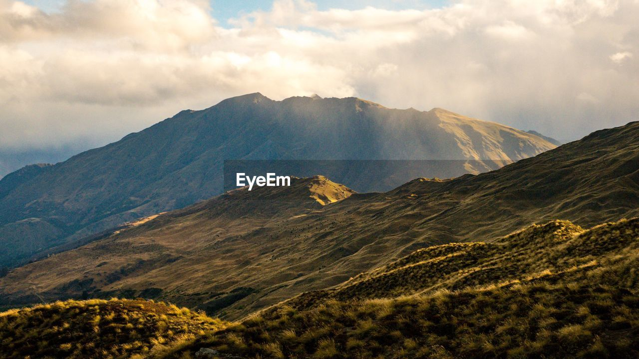 mountain, sky, cloud - sky, scenics - nature, beauty in nature, tranquil scene, landscape, tranquility, environment, non-urban scene, mountain range, nature, idyllic, no people, day, land, remote, volcano, geology, travel, mountain peak, outdoors, volcanic crater, mountain ridge, range