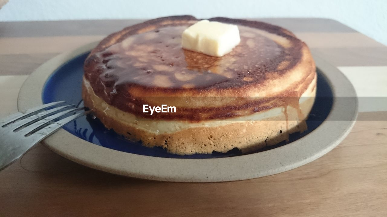 Close-up of pancake served in plate on table