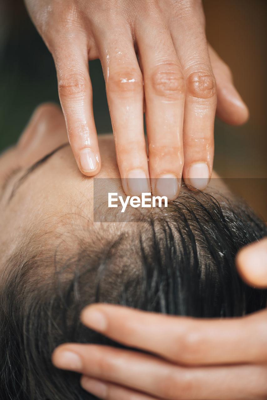 Woman enjoying ayurvedic oil treatment for healthy hair