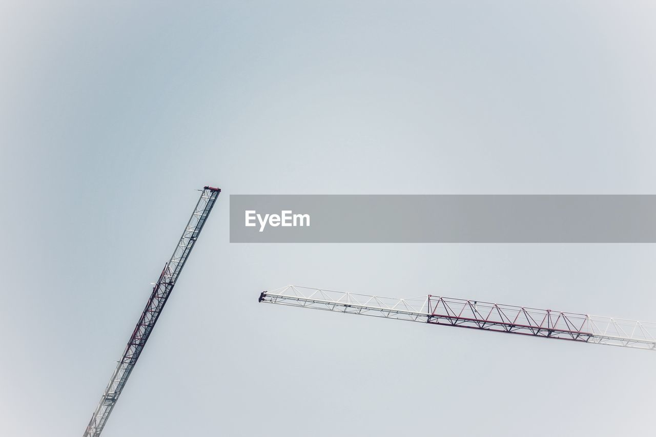 sky, crane - construction machinery, construction industry, development, industry, copy space, machinery, construction site, low angle view, nature, no people, day, clear sky, tall - high, metal, architecture, construction equipment, outdoors, crane, incomplete
