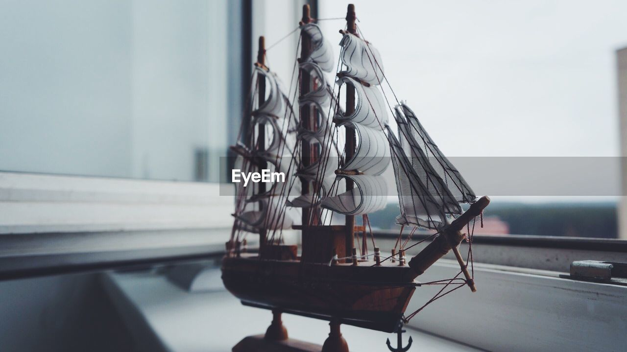 Figurine Of Sailboat On Window Sill At Home
