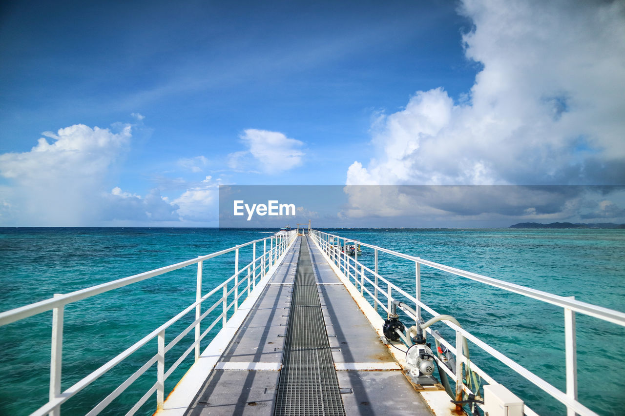 sky, water, railing, sea, cloud - sky, horizon over water, horizon, transportation, the way forward, day, nature, blue, direction, scenics - nature, beauty in nature, mode of transportation, diminishing perspective, outdoors, travel