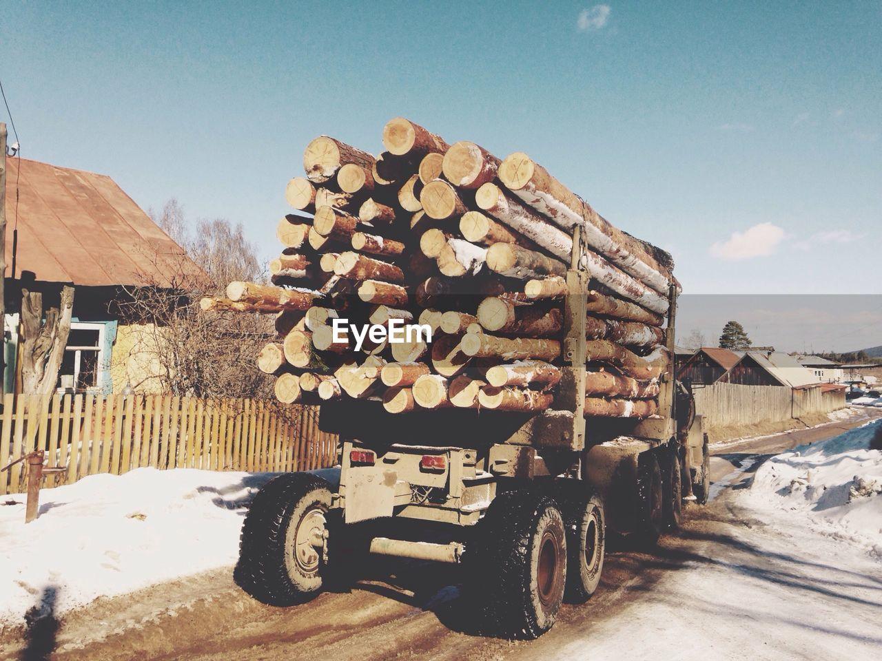 Logging truck pulling fresh cut log