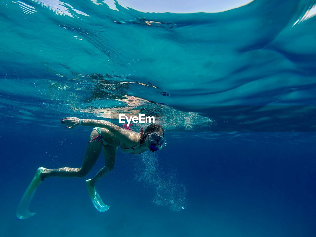 High angle view of person swimming underwater