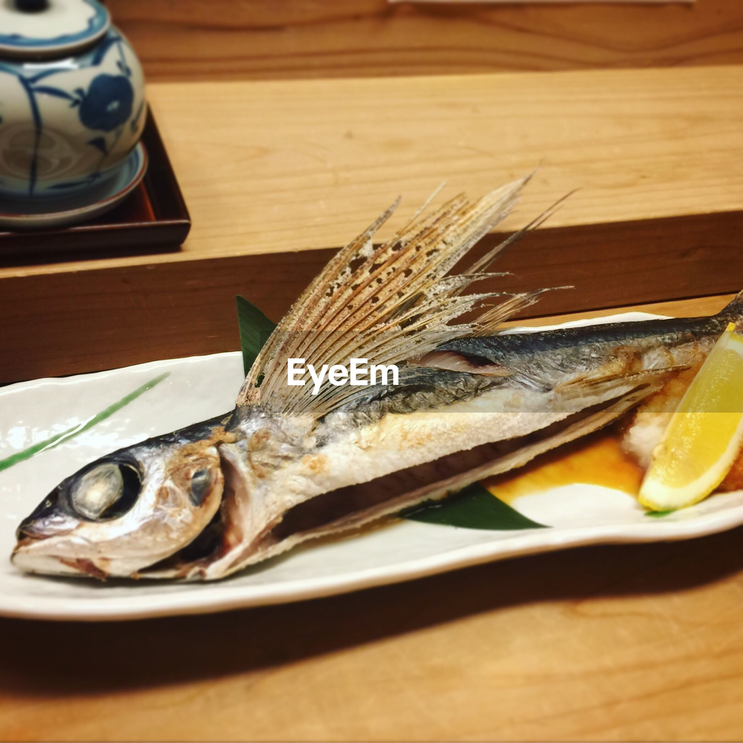 High angle view of seafood served in plate on wooden table