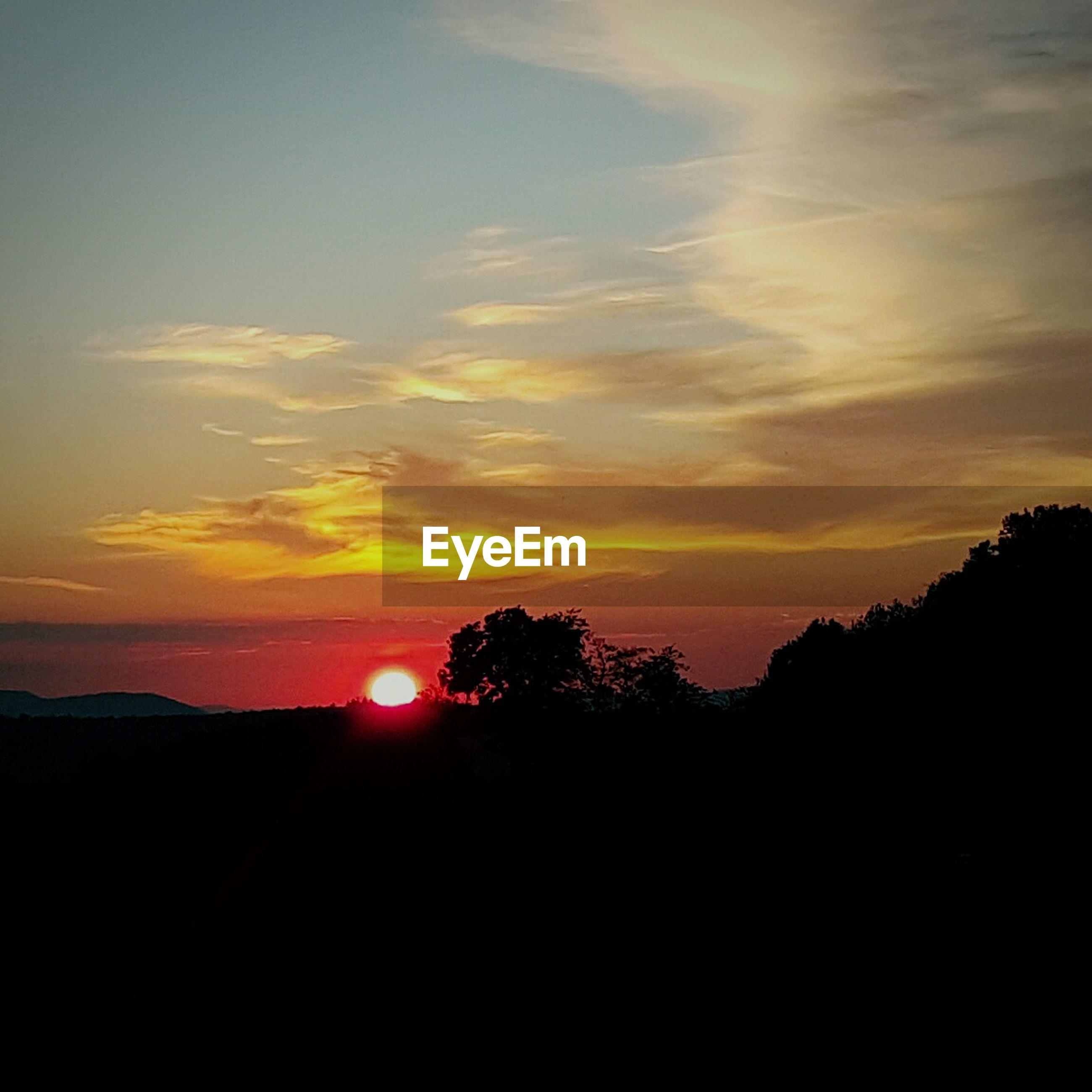 sunset, silhouette, scenics, tranquil scene, sky, tranquility, beauty in nature, orange color, idyllic, sun, nature, cloud - sky, landscape, cloud, dark, tree, outdoors, outline, sunlight, copy space