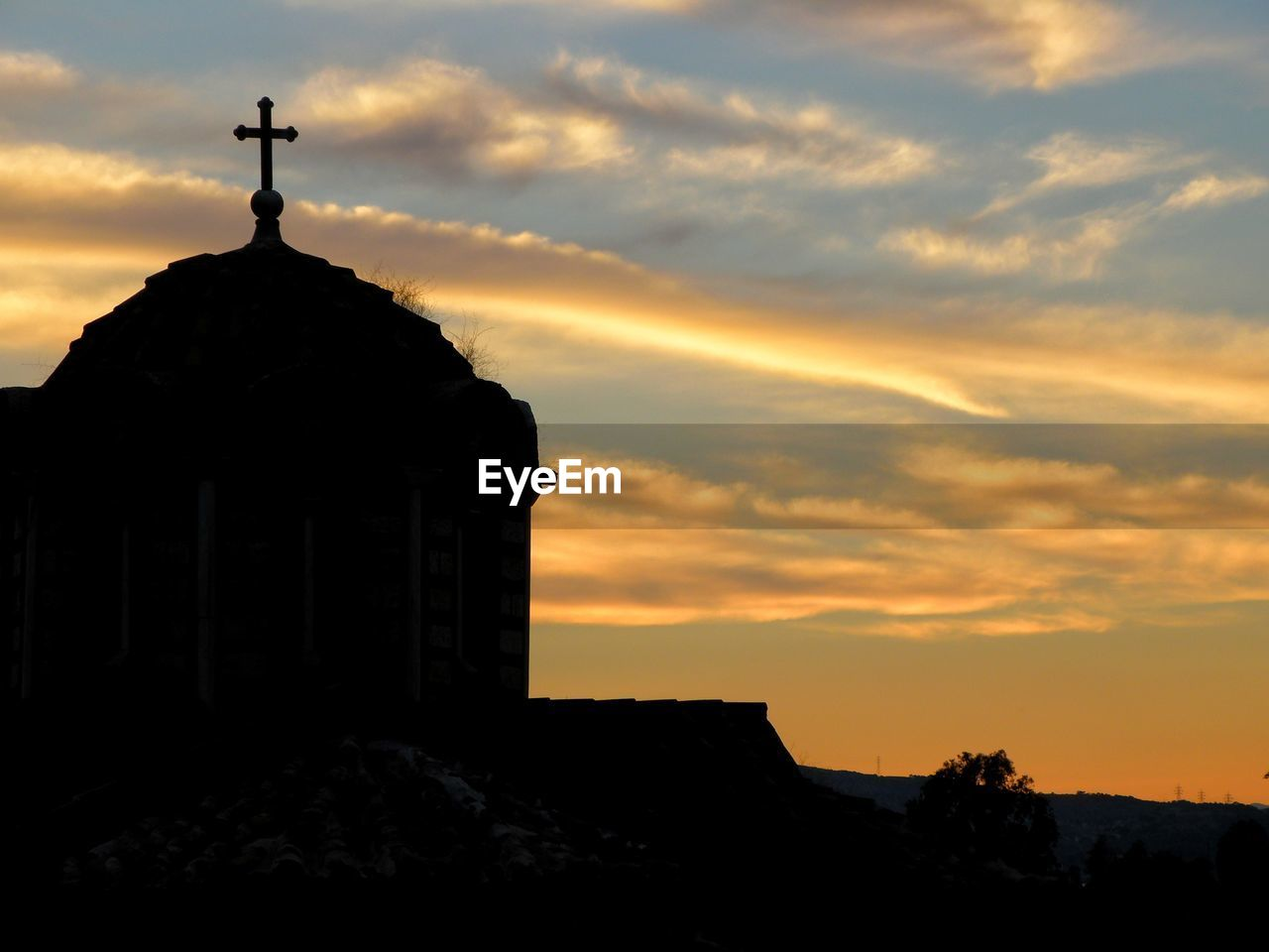 Silhouette church against sky during sunset