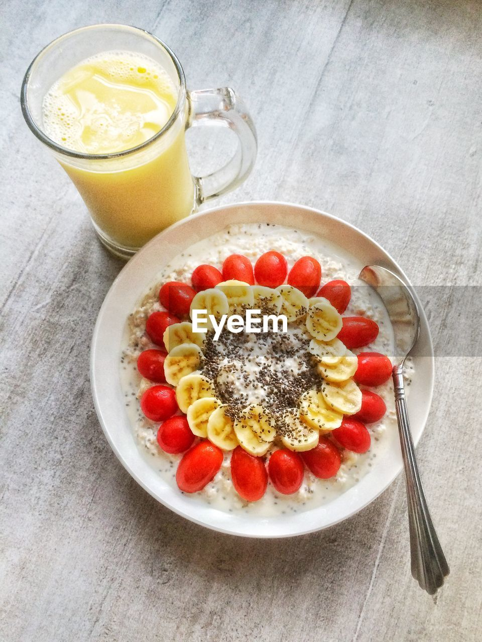 food and drink, fruit, drink, freshness, healthy eating, breakfast, food, drinking glass, refreshment, table, no people, high angle view, indoors, slice, banana, serving size, ready-to-eat, orange juice, sweet food, close-up, day