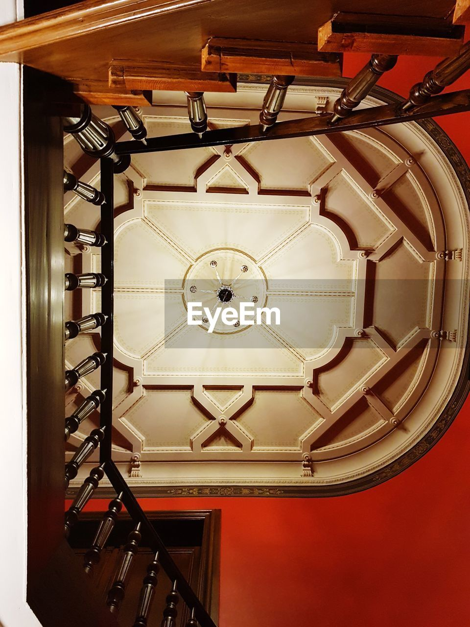 indoors, clock, no people, time, pattern, ceiling, architecture, clock face, roman, shape, hanging, roman numeral, built structure, geometric shape, metal, accuracy, low angle view, luxury, minute hand, wealth, directly below