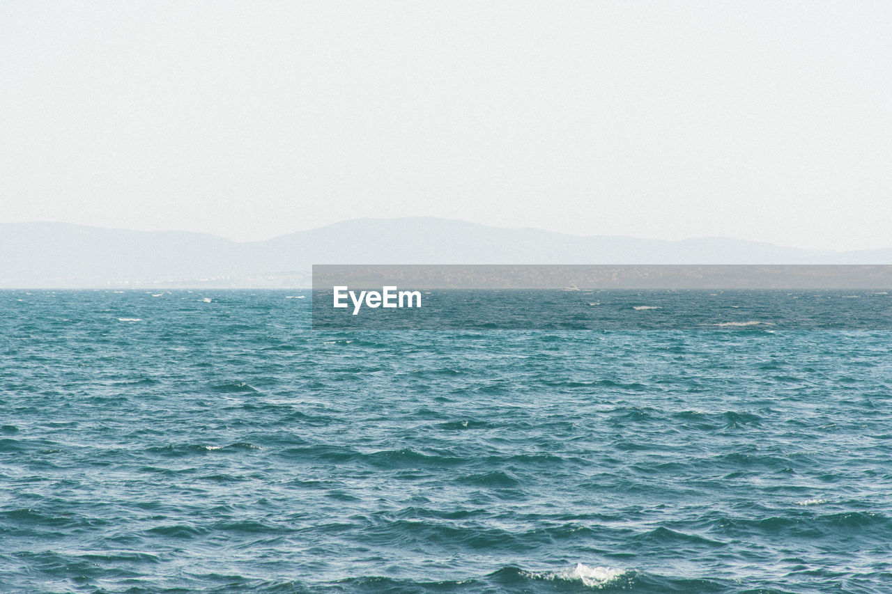 sea, no people, water, nature, beauty in nature, scenics, tranquility, clear sky, mountain, outdoors, waterfront, tranquil scene, day, blue, wave, sky