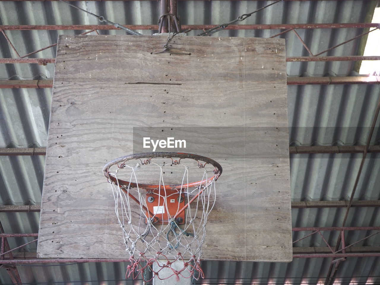 basketball hoop, basketball - sport, sport, no people, net - sports equipment, metal, day, architecture, built structure, outdoors, low angle view, sports equipment, absence, close-up, protection, hanging, nature, container, shape, ceiling