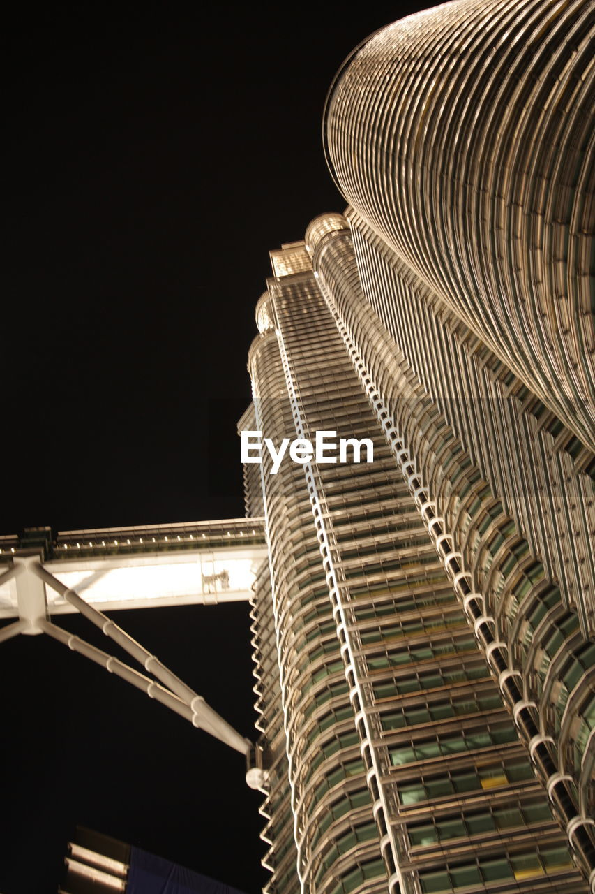 built structure, architecture, building exterior, night, illuminated, low angle view, city, no people, sky, building, nature, office building exterior, skyscraper, modern, travel, outdoors, connection, transportation, travel destinations, tourism