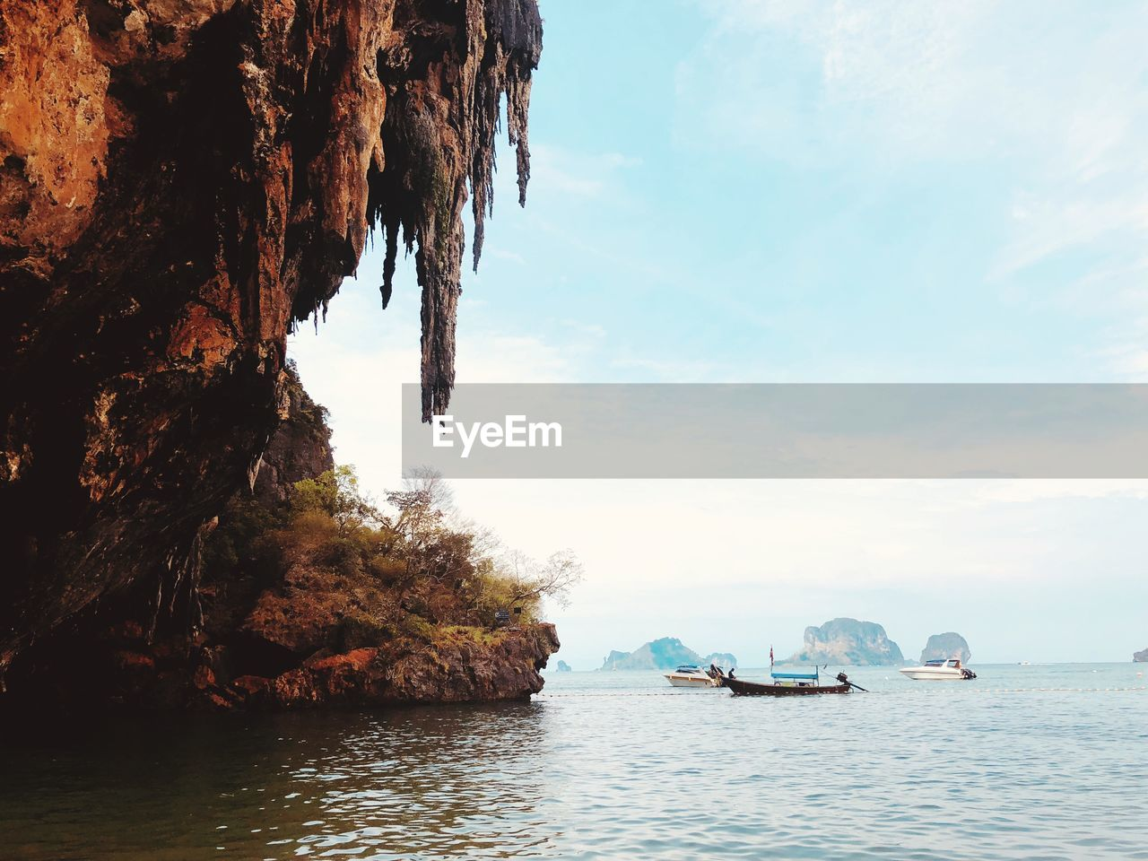 water, sky, sea, waterfront, rock, nature, scenics - nature, beauty in nature, transportation, day, rock formation, cloud - sky, tranquil scene, nautical vessel, rock - object, tranquility, solid, no people, mode of transportation, outdoors, stack rock