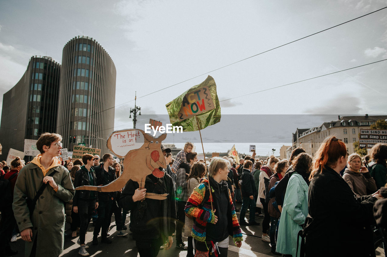crowd, large group of people, group of people, real people, building exterior, men, architecture, city, sky, built structure, protest, women, adult, nature, day, lifestyles, street, text, communication, outdoors, protestor