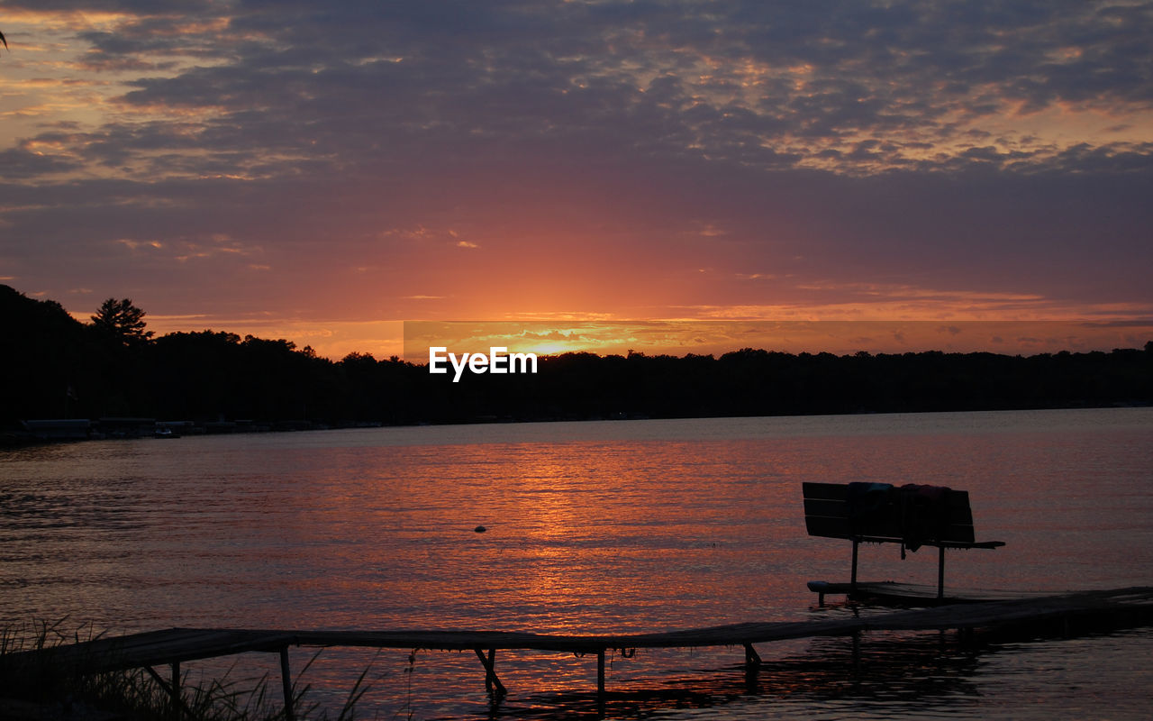 sunset, orange color, beauty in nature, scenics, nature, silhouette, tranquility, sky, tranquil scene, lake, water, outdoors, no people, tree, day