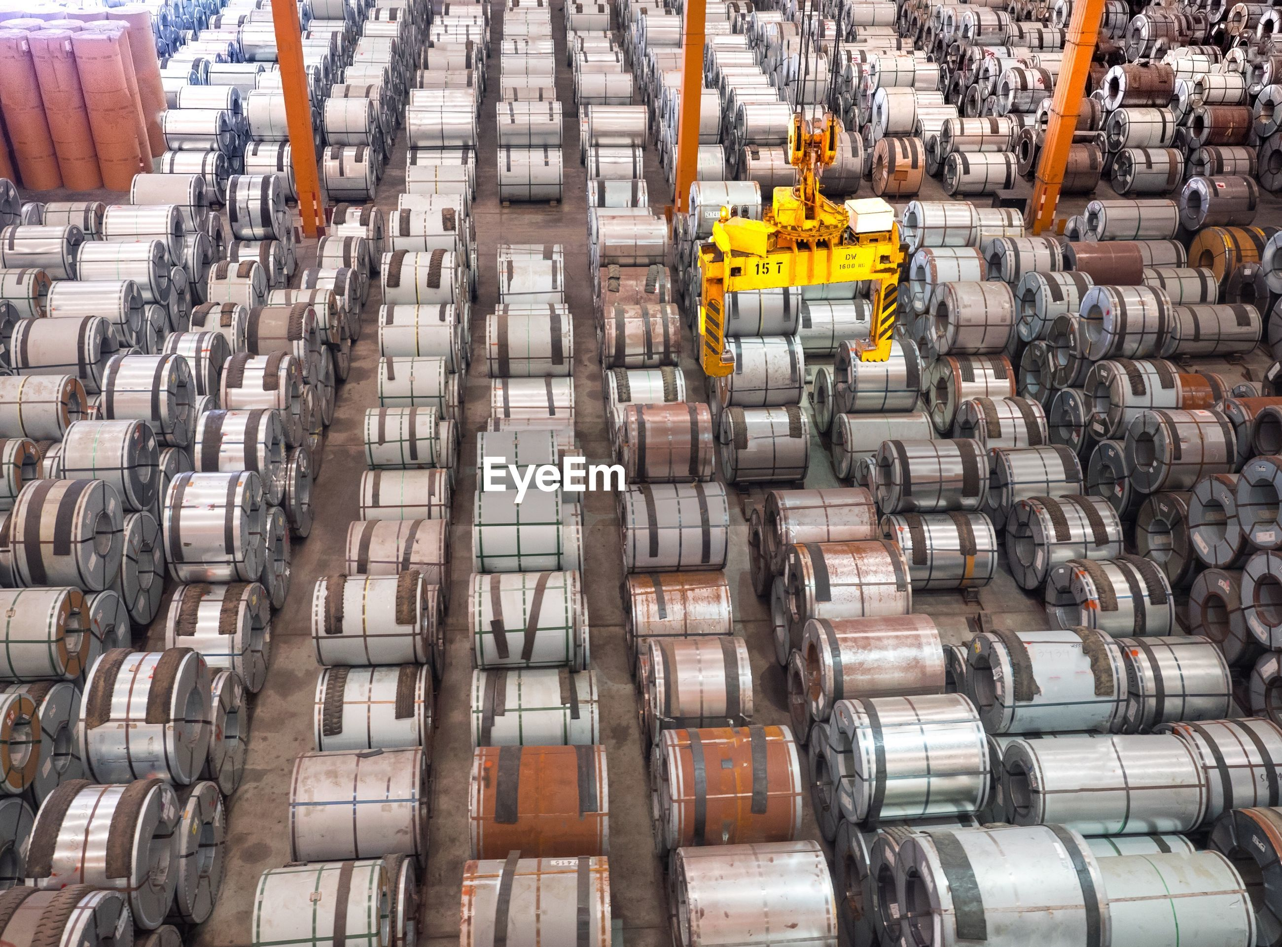 High angle view of huge rolled up cables at industry