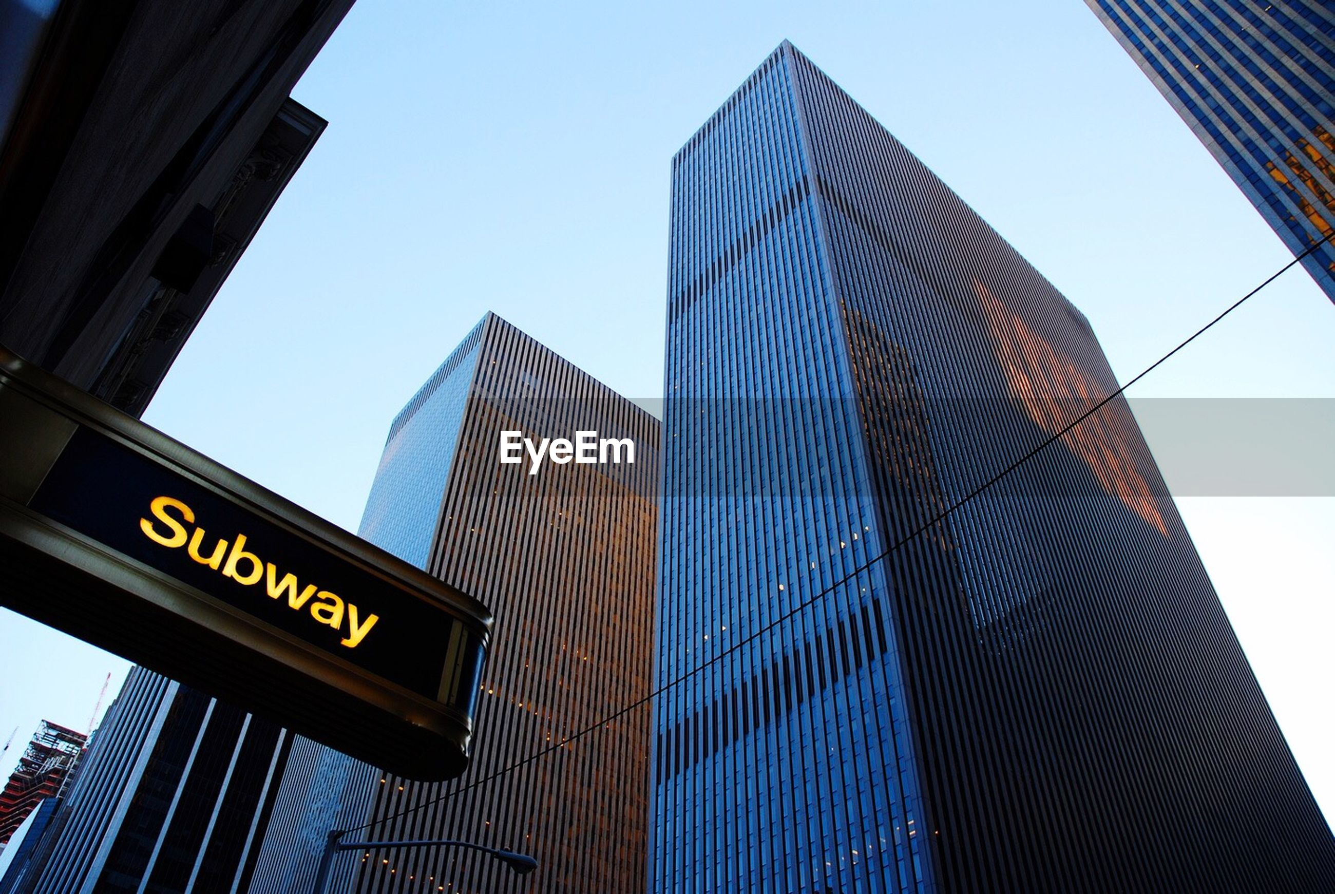 Low angle view of tall buildings against clear sky