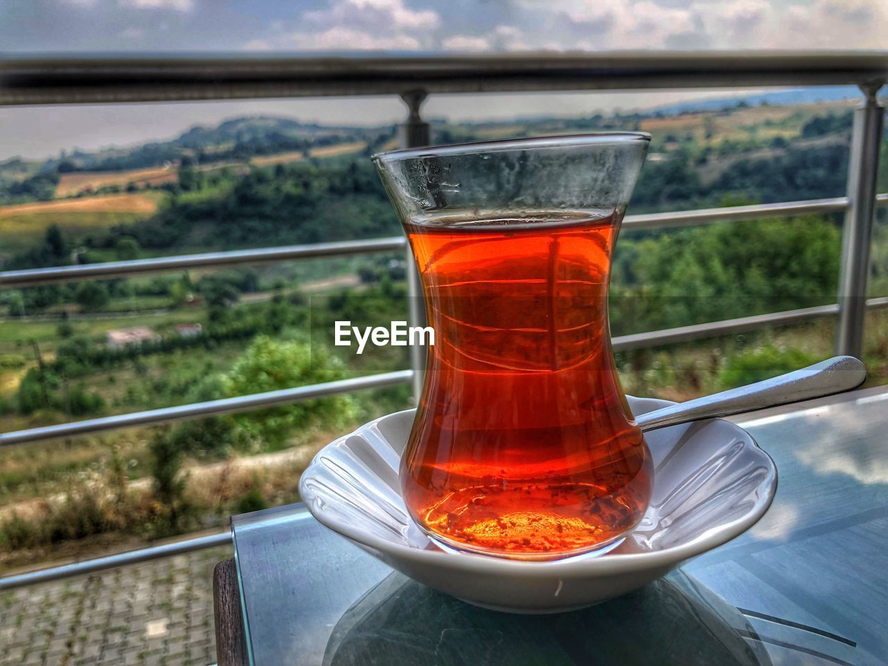 food and drink, drink, tea, crockery, saucer, refreshment, tea - hot drink, hot drink, transparent, close-up, cup, glass - material, focus on foreground, kitchen utensil, day, no people, nature, spoon, tea cup, mug, outdoors, glass