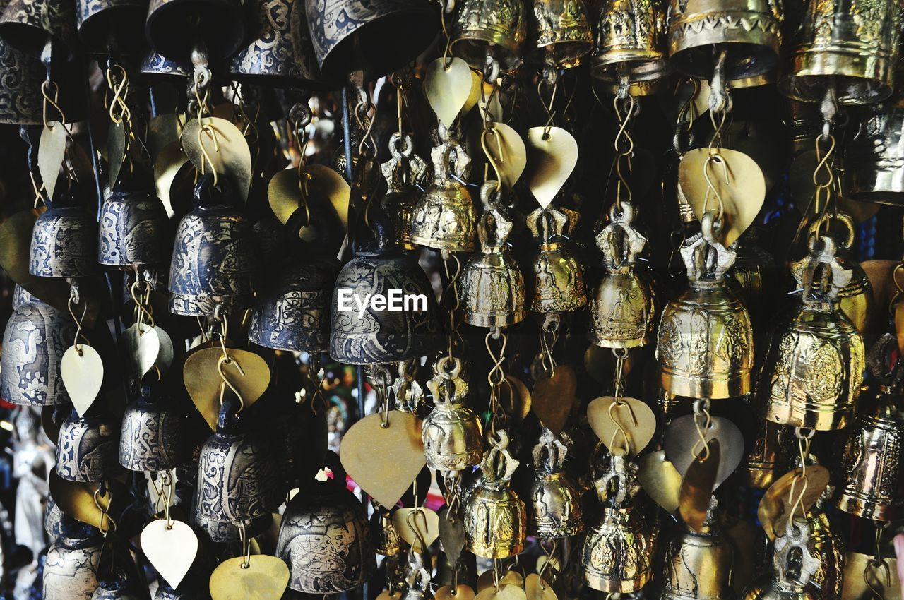 Close-Up Of Metal Decorations Hanging At Store