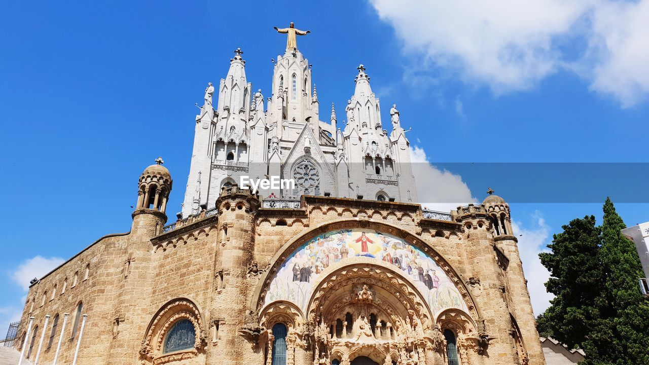 architecture, sky, building exterior, built structure, religion, place of worship, low angle view, belief, spirituality, building, nature, travel destinations, day, the past, history, travel, no people, arch, outdoors