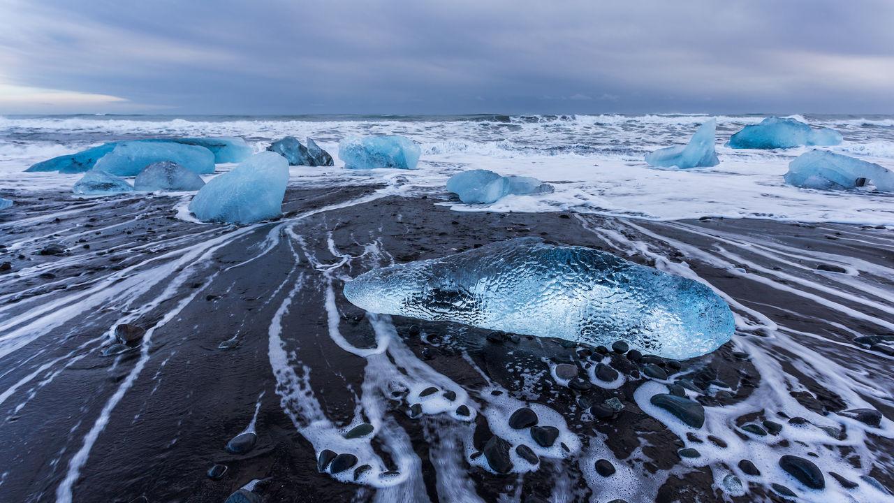 Pieces of ice on jokulsarlon diamond beach, iceland