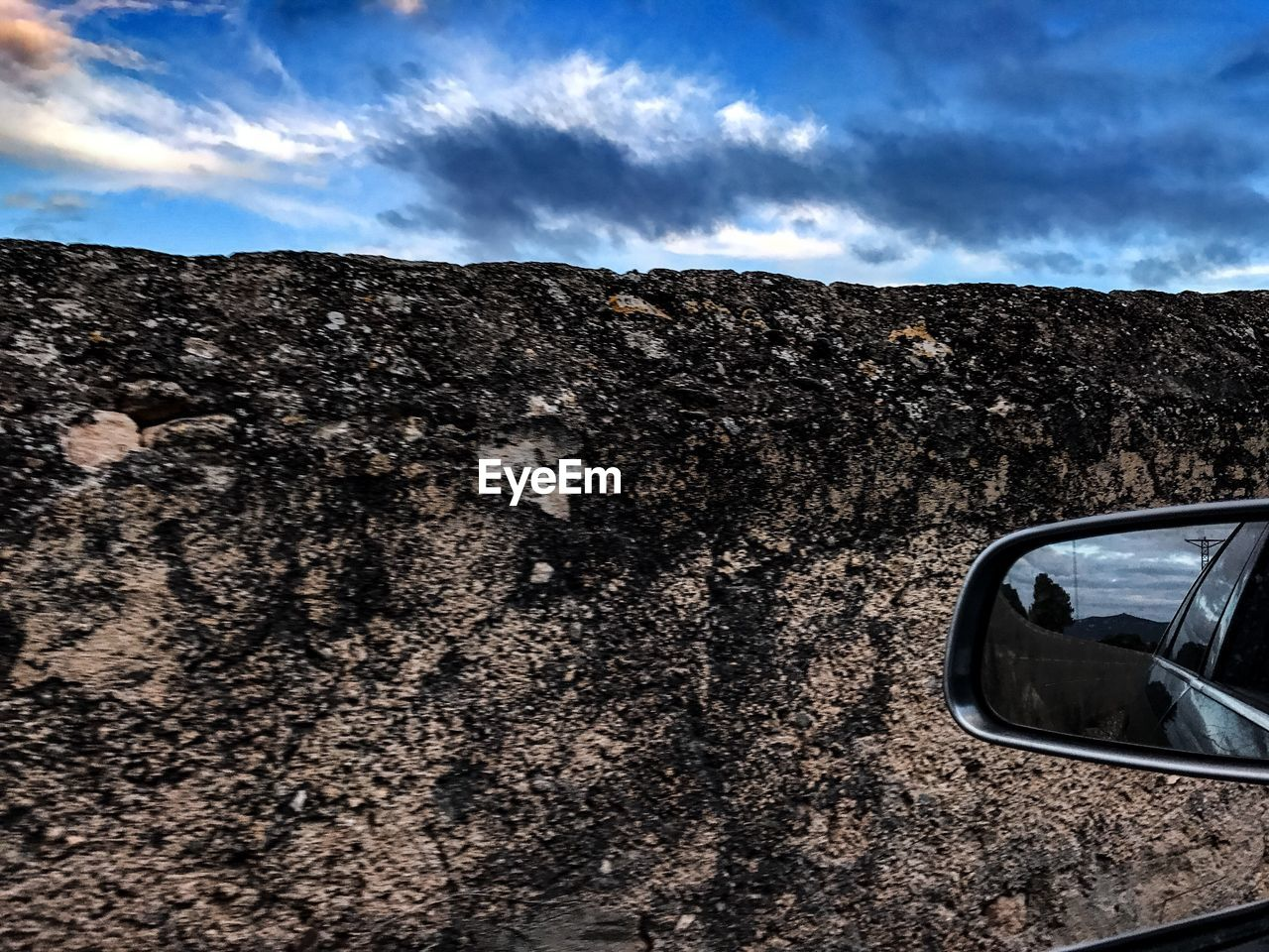 car, sky, land vehicle, side-view mirror, transportation, cloud - sky, mode of transport, outdoors, day, mountain, nature, landscape, no people, vehicle mirror, beauty in nature
