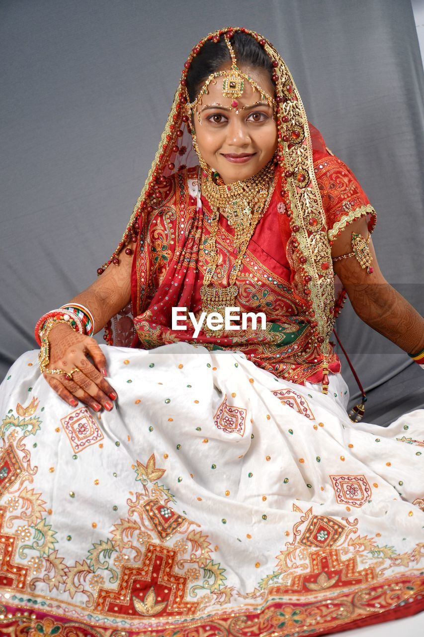 front view, real people, women, traditional clothing, indoors, lifestyles, clothing, portrait, smiling, young women, leisure activity, females, people, newlywed, adult, young adult, wedding ceremony, beautiful woman