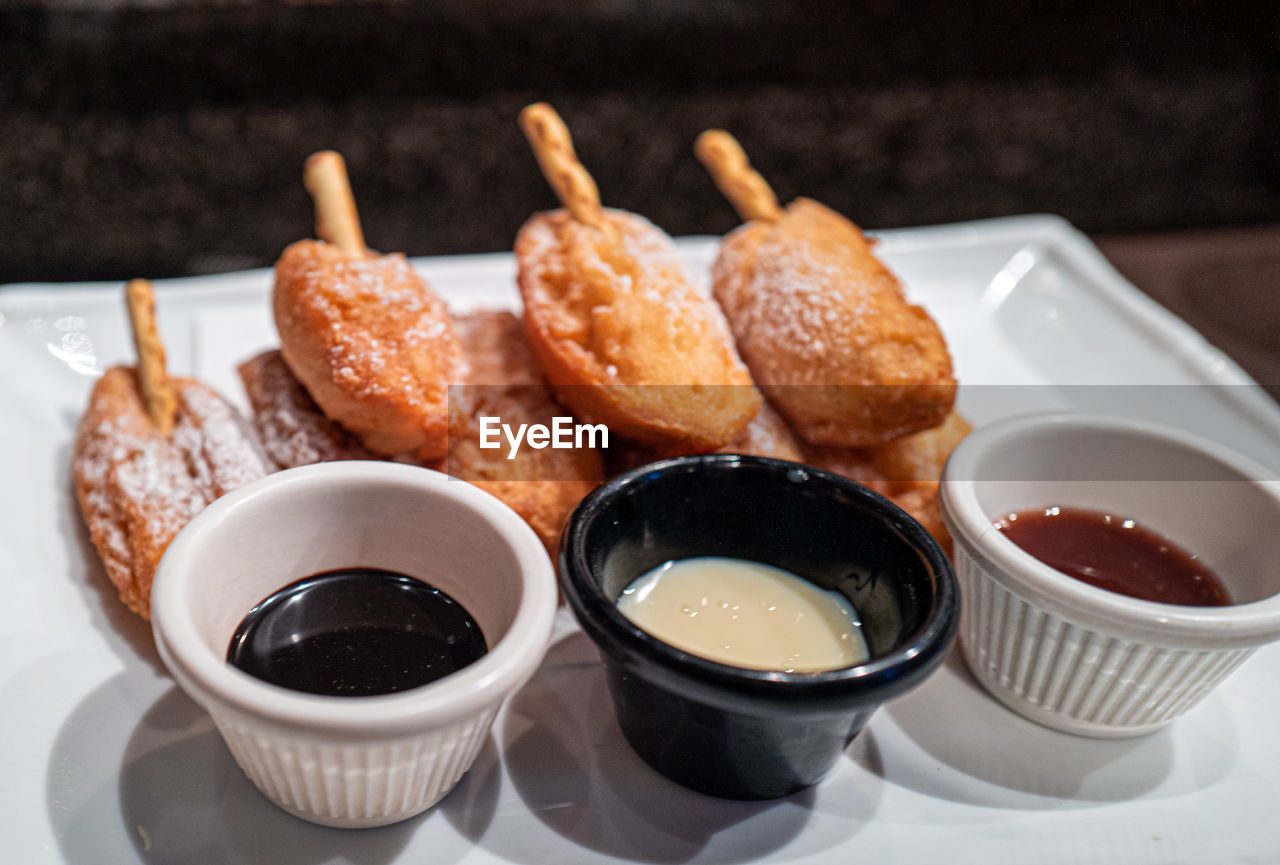 food and drink, food, ready-to-eat, still life, freshness, indoors, sweet food, plate, no people, sauce, condiment, table, close-up, serving size, focus on foreground, bowl, indulgence, fried, sweet, meal, temptation, snack, breakfast, tray