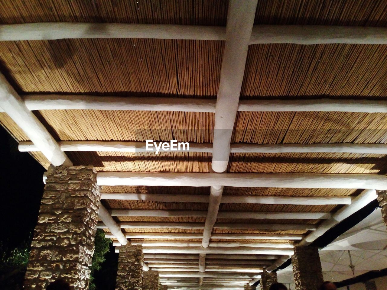 ceiling, roof beam, architecture, low angle view, indoors, built structure, no people, roof, illuminated, day, close-up