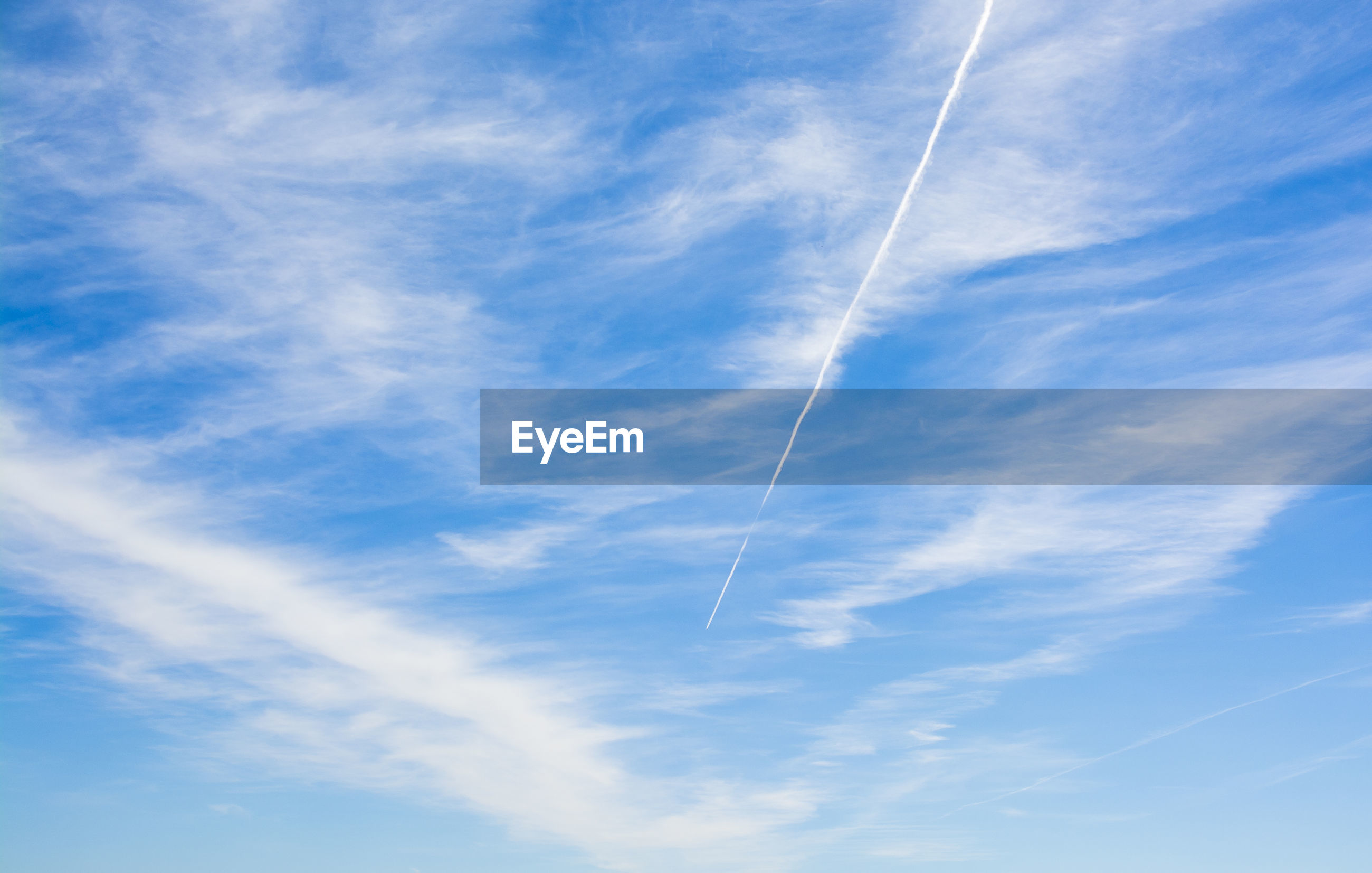 LOW ANGLE VIEW OF VAPOR TRAIL IN THE SKY