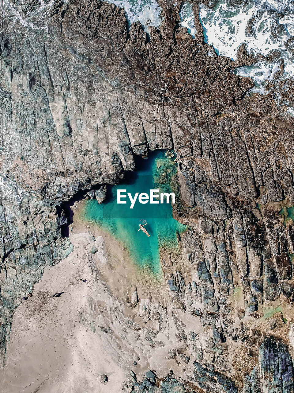 High Angle View Of Rock Formations In Water