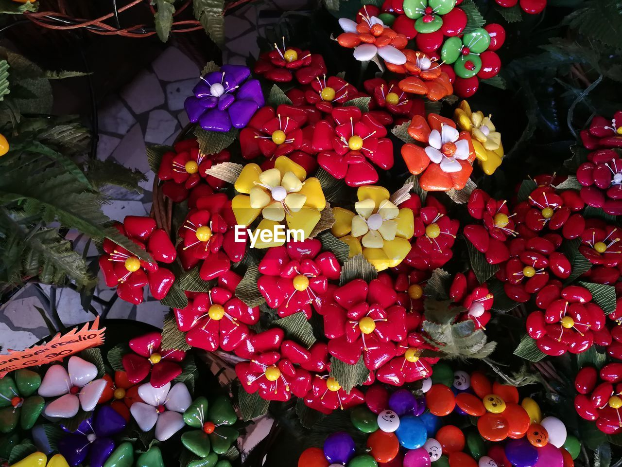 flower, flowering plant, plant, beauty in nature, petal, freshness, growth, flower head, fragility, inflorescence, vulnerability, close-up, nature, no people, red, high angle view, day, plant part, multi colored, outdoors, bunch of flowers, bouquet, flower arrangement