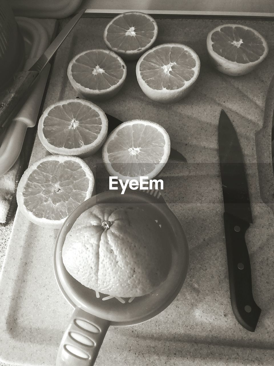 food, food and drink, fruit, citrus fruit, healthy eating, wellbeing, freshness, slice, high angle view, indoors, table, lemon, still life, knife, orange, kitchen knife, orange - fruit, cross section, no people, directly above