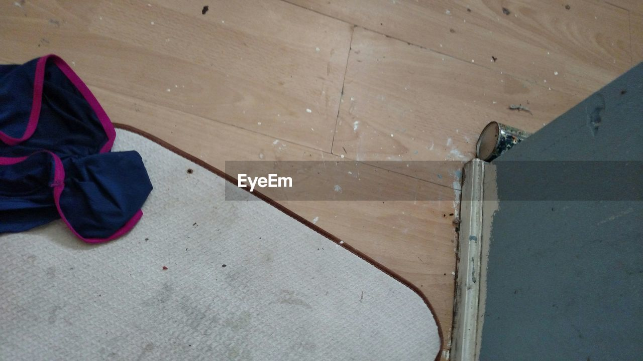 High Angle View Of Cloth On Doormat