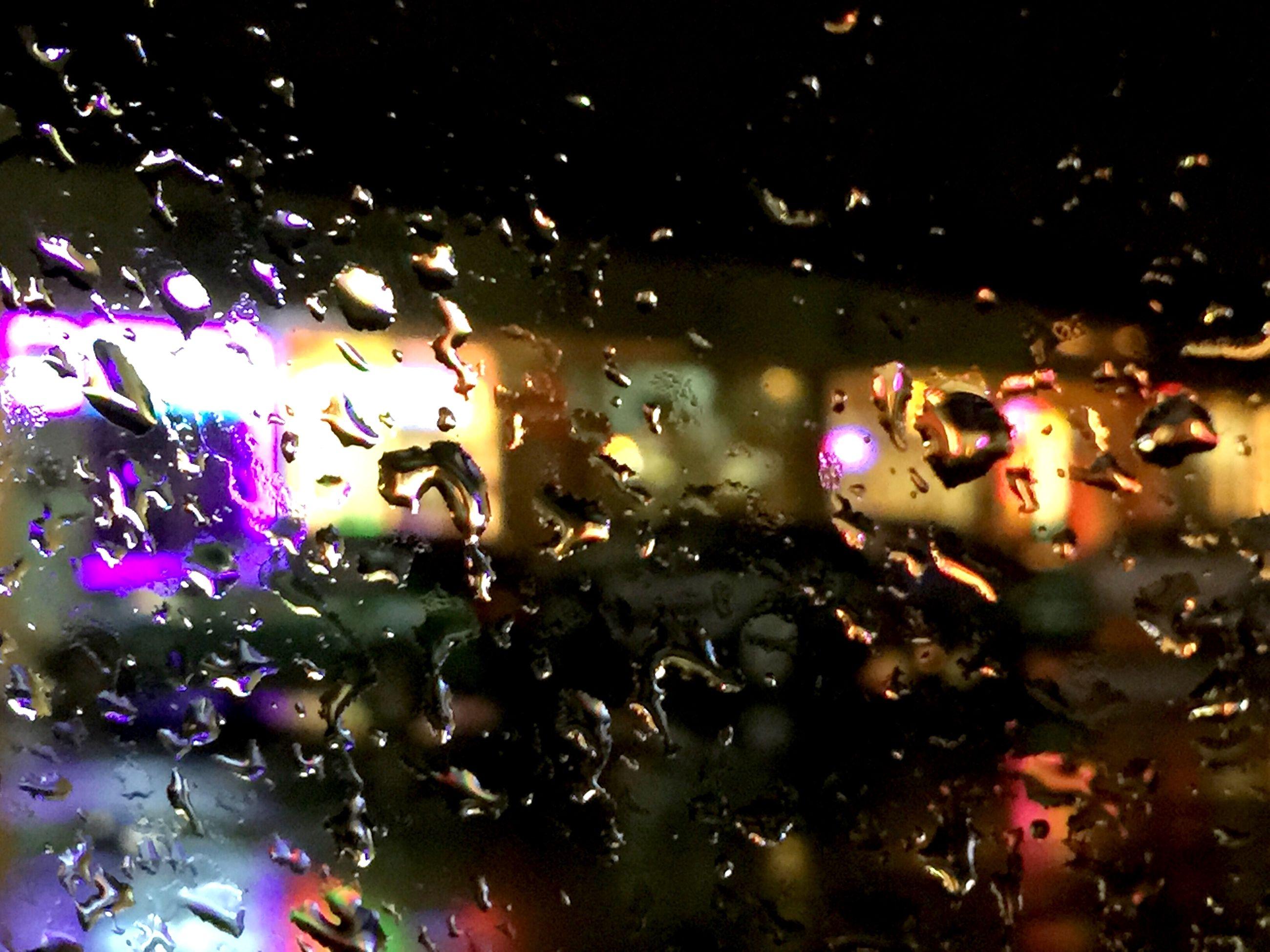 Full frame shot of wet car window during monsoon
