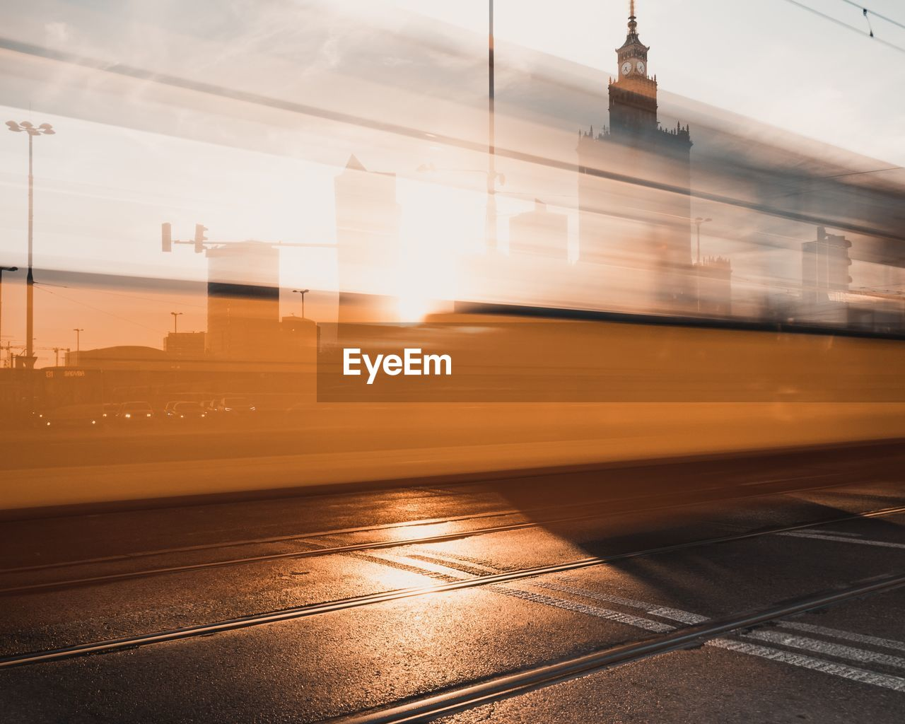 Blurred Motion Of Tram On Road In City During Sunset