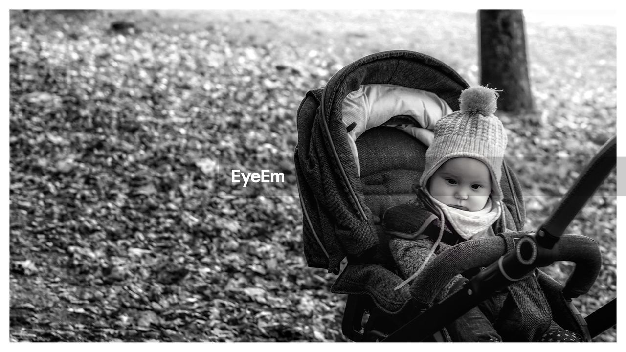 transfer print, childhood, auto post production filter, day, child, focus on foreground, clothing, nature, representation, toy, cute, human representation, winter, land, hat, warm clothing, people, two people, emotion, outdoors, innocence