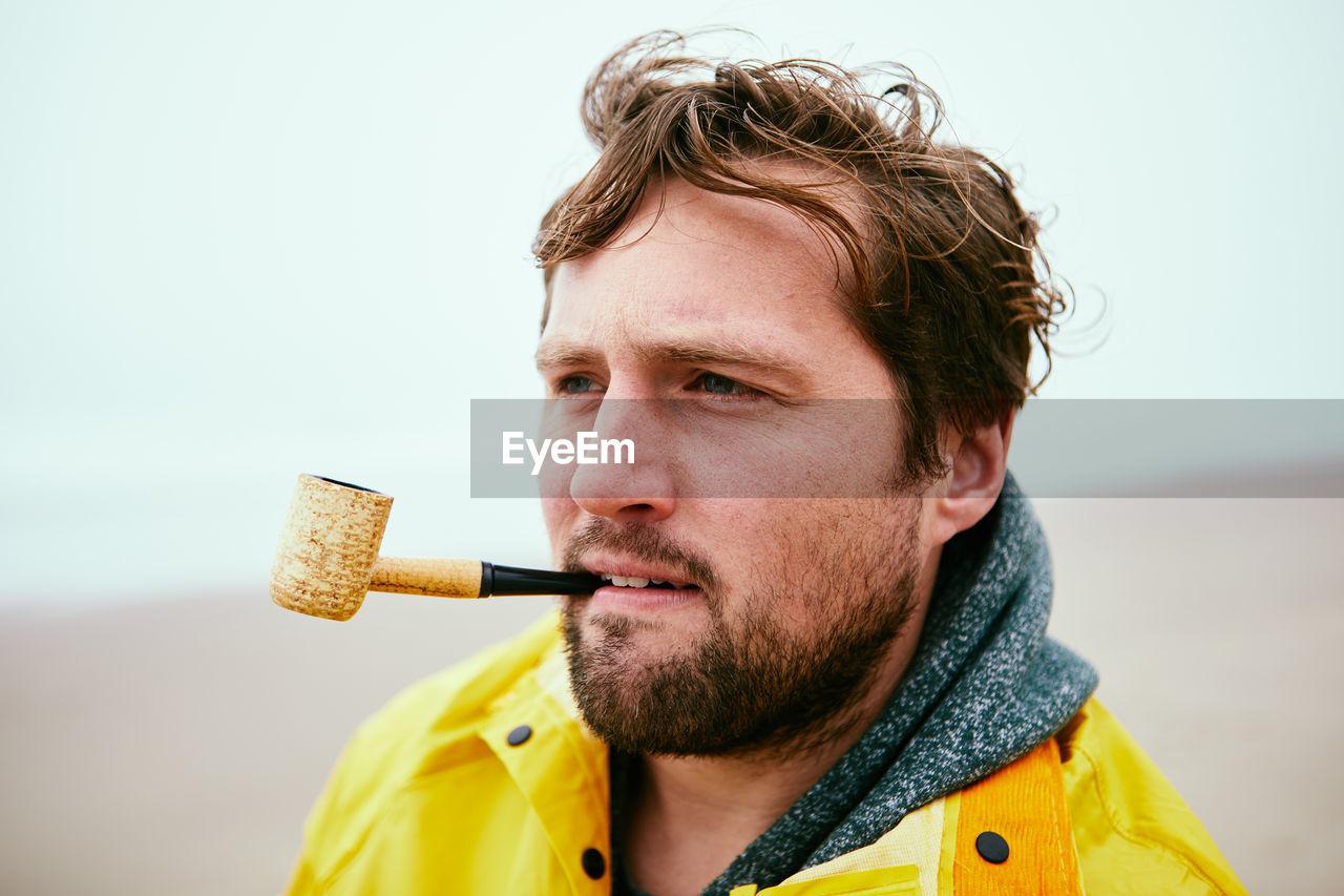 Man Smoking At Beach