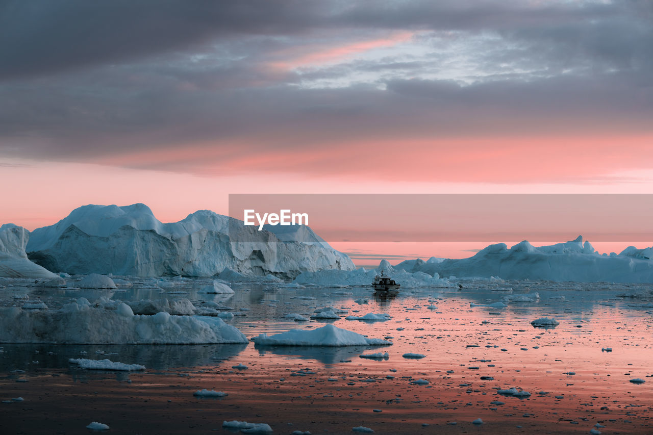 sky, water, cloud - sky, sunset, scenics - nature, beauty in nature, tranquility, tranquil scene, ice, sea, glacier, nature, cold temperature, winter, no people, frozen, idyllic, rock, orange color, iceberg, outdoors