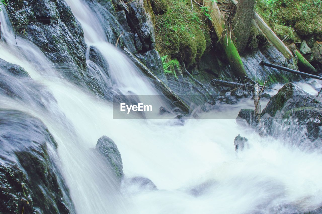 water, long exposure, motion, waterfall, blurred motion, scenics - nature, flowing water, rock, beauty in nature, forest, solid, rock - object, tree, flowing, nature, no people, land, river, sport, outdoors, power in nature, falling water