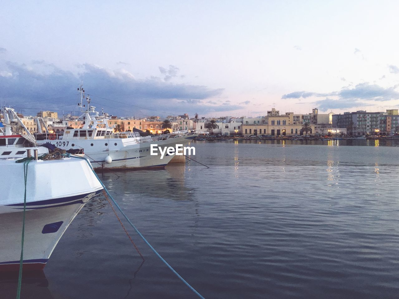 water, nautical vessel, building exterior, architecture, built structure, mode of transportation, transportation, city, sky, cloud - sky, nature, moored, sea, no people, building, harbor, waterfront, residential district, outdoors, cityscape, yacht, passenger craft, marina, cruise ship