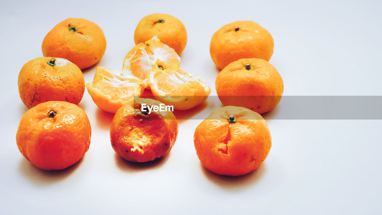 food and drink, food, healthy eating, orange color, wellbeing, freshness, fruit, studio shot, still life, white background, orange - fruit, indoors, orange, no people, citrus fruit, group of objects, close-up, persimmon, medium group of objects, high angle view