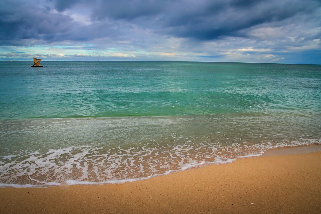 sea, water, beach, land, sky, cloud - sky, scenics - nature, horizon over water, horizon, beauty in nature, tranquil scene, tranquility, aquatic sport, sand, nature, idyllic, surfing, wave, sport, outdoors, turquoise colored