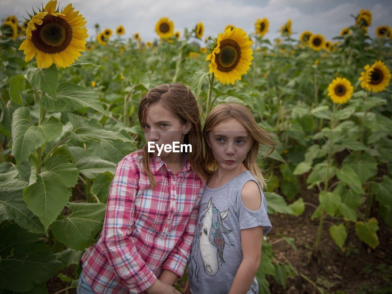 Two Girls Posing On Field