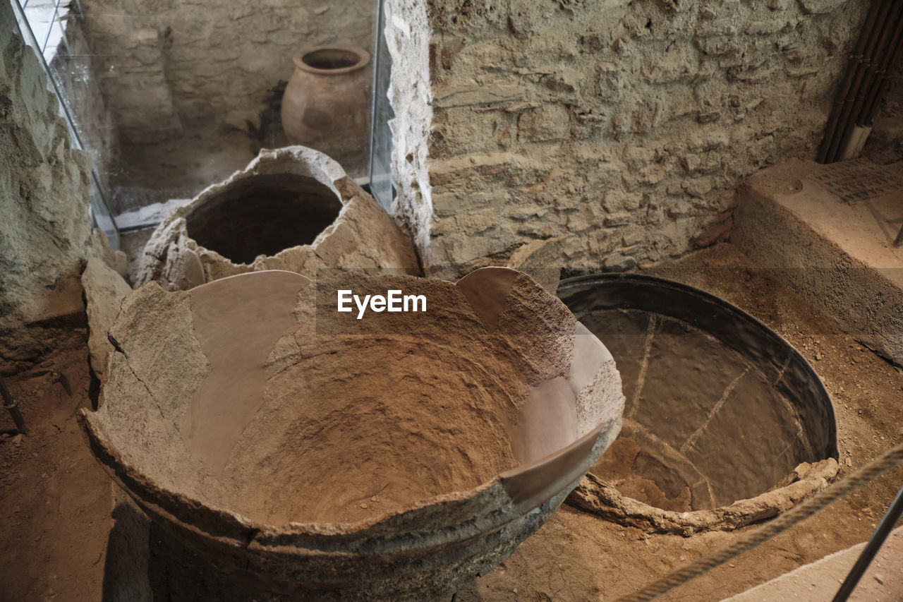 indoors, container, no people, high angle view, close-up, food and drink, freshness, wellbeing, healthy eating, still life, food, focus on foreground, architecture, old, day, nature, wood - material, bowl, industry, wall - building feature