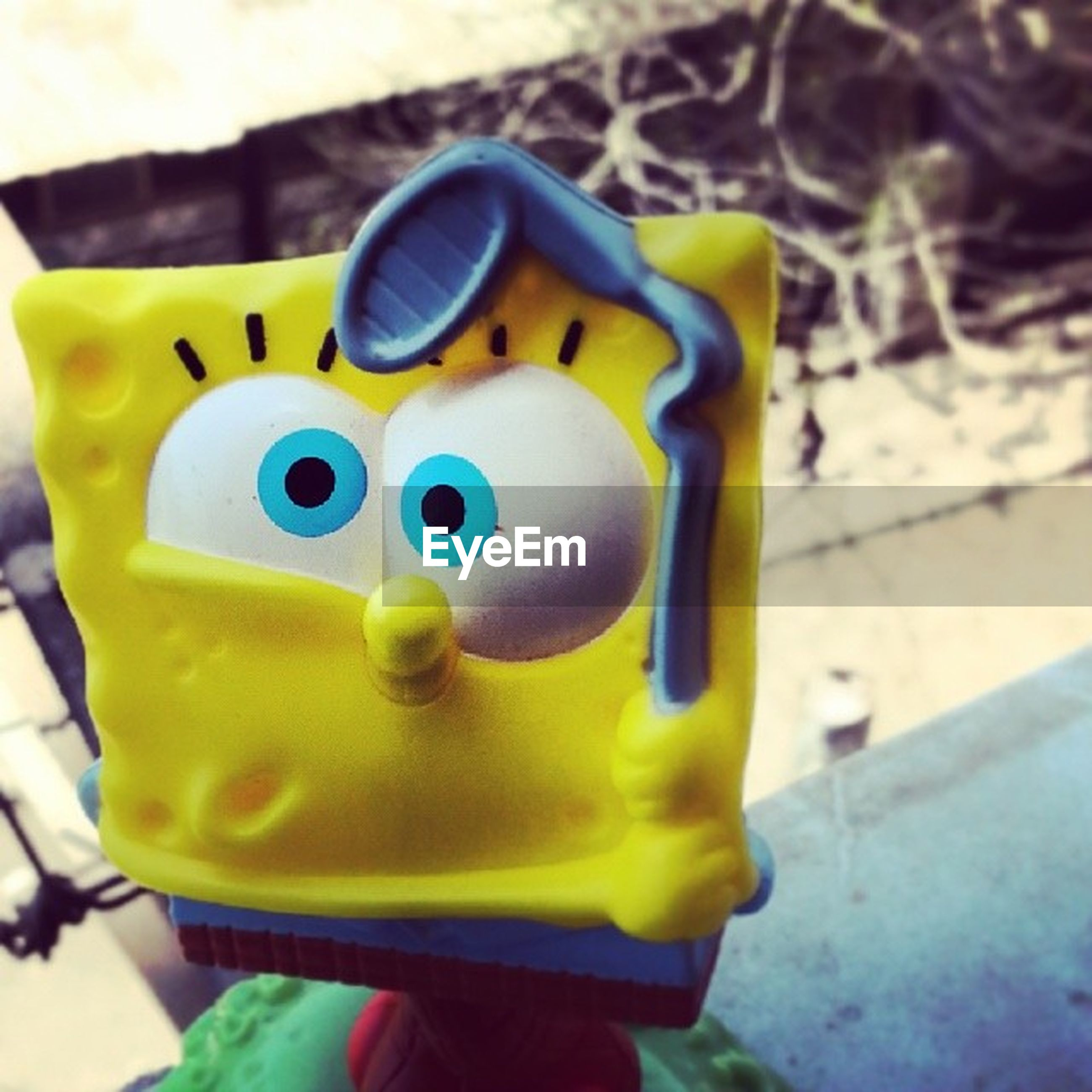 yellow, toy, childhood, multi colored, close-up, focus on foreground, plastic, blue, day, animal representation, creativity, still life, art, outdoors, no people, human representation, street, art and craft, sunlight, colorful