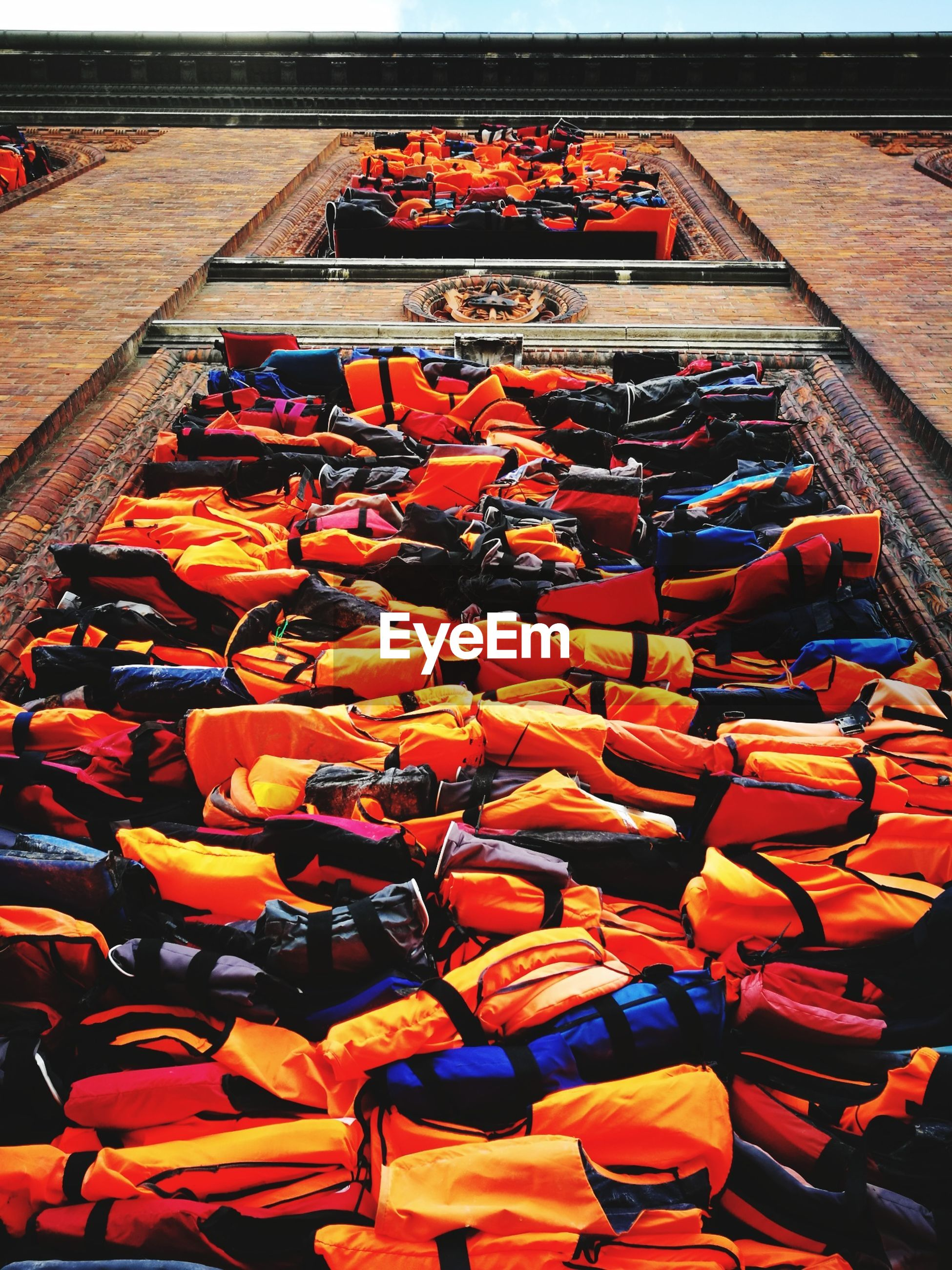 High angle view of life jackets at harbor