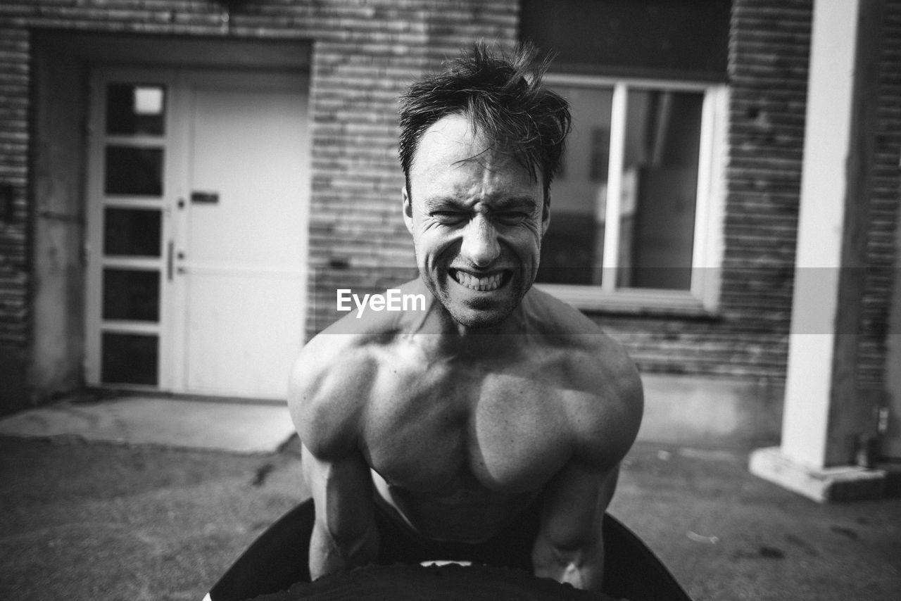 Mature Man Exercising In Backyard